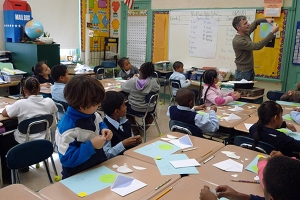 The artist working with students at the Nathan Hale School on Fort Hill, Roxbury